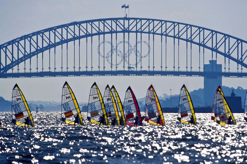 © Sport the library/Greg Ford Sydney 2000 Olympic Games Sailing, Day 6, Mistrals General Action with Sydney Harbour Bridge in the background and the Olympic Rings
