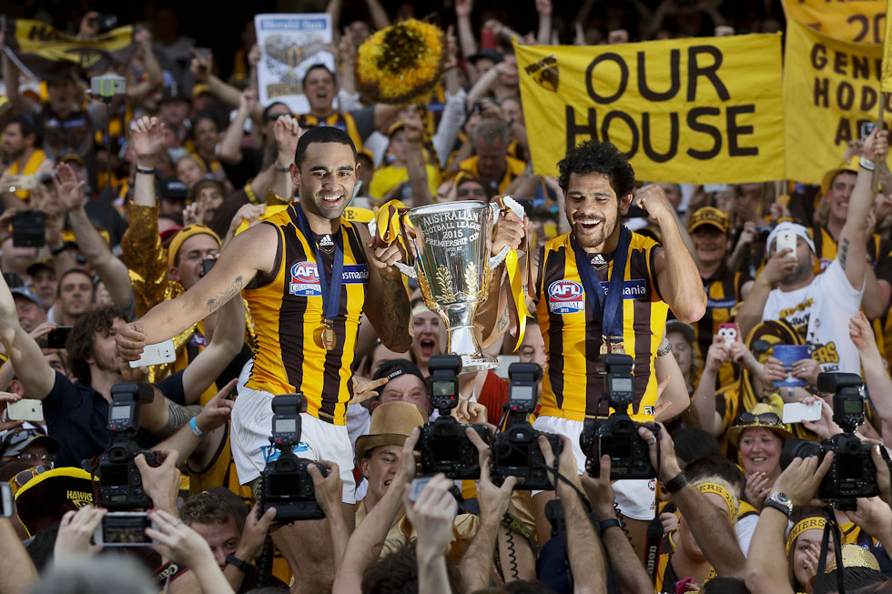 MELBOURNE, AUSTRALIA - OCTOBER 3: Hawthorn's Shaun Burgoyne (L) and Cyril Rioli hold the Premiership Cup during the 2015 Toyota AFL Grand Final match between the Hawthorn Hawks and the West Coast Eagles at the Melbourne Cricket Ground, Melbourne, Australia on October 3, 2015. (Photo by Greg Ford/AFL Media)